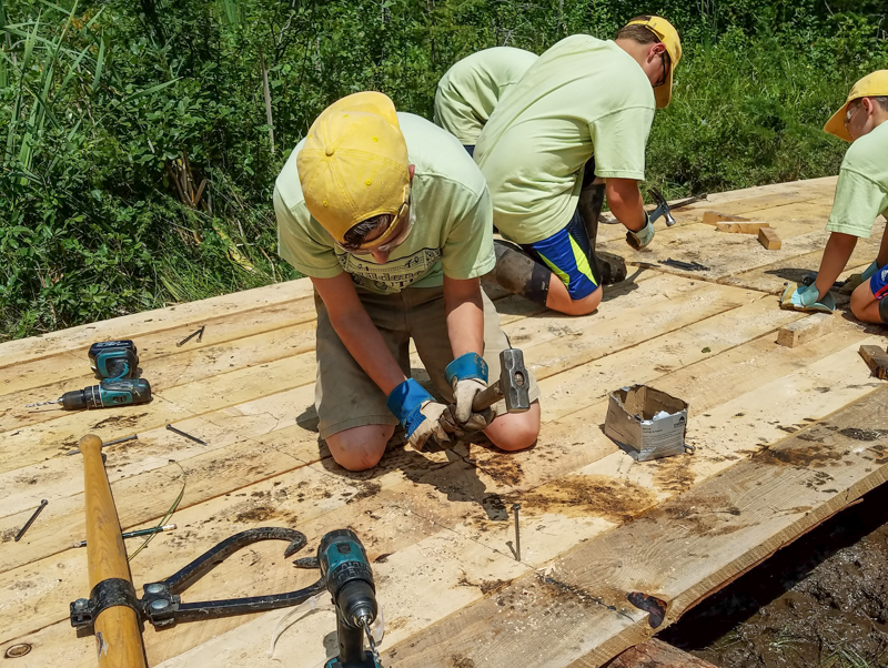 Hildene Youth Corps securing planks